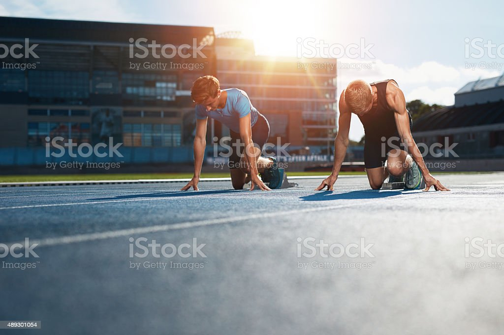 Young athletes preparing to race stock photo