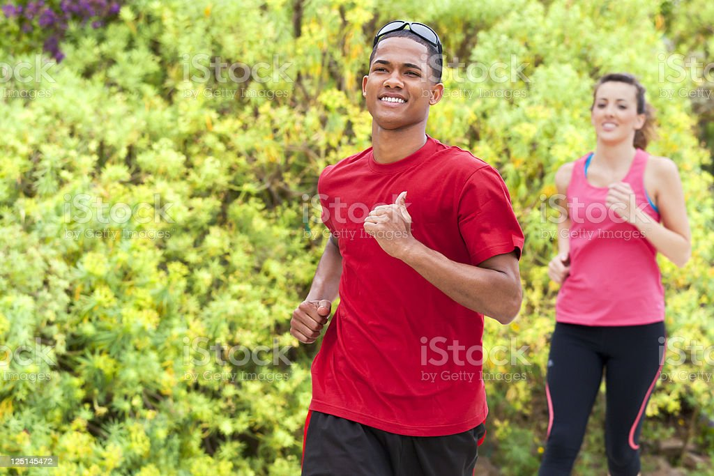 Young athletes running in the park stock photo