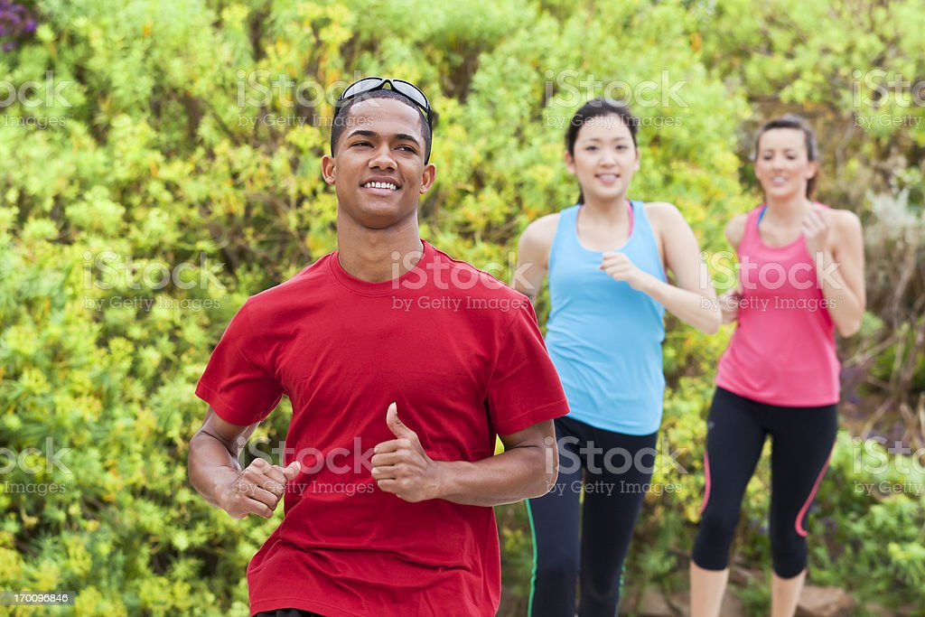Young athletes running in the park royalty-free stock photo
