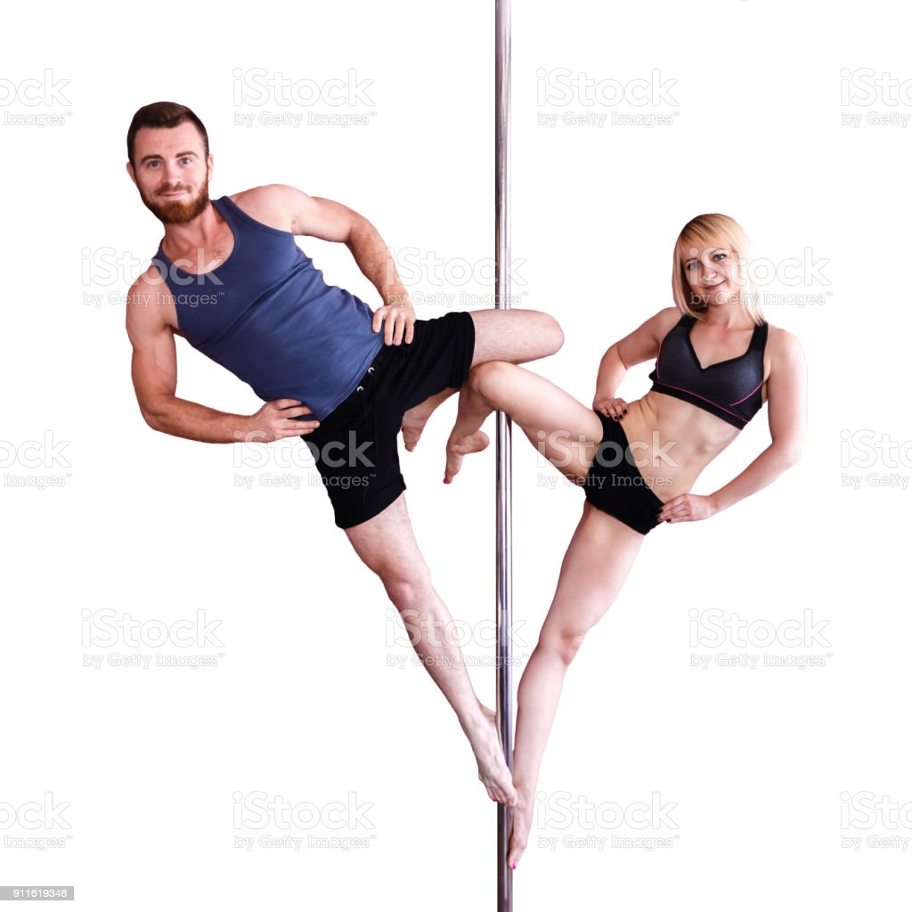 Young athletic blonde woman and bearded man doing strength exercises on a pylon. stock photo