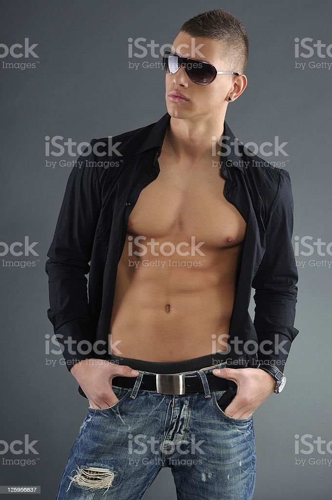 young athletic fashion man posing royalty-free stock photo