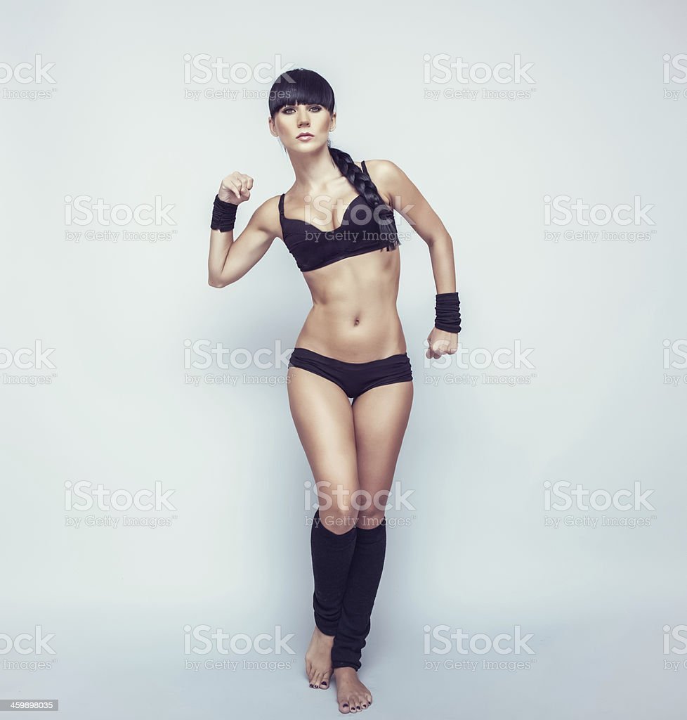 young athletic girl at a wall stock photo