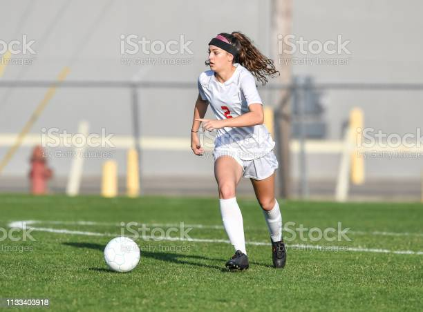 Young athletic girl playing with a soccer ball in a green grass field picture id1133403918?b=1&k=6&m=1133403918&s=612x612&h=hzthmirbqqmjecokpwdmb0fgvewmwjxtijrlpjyojhk=