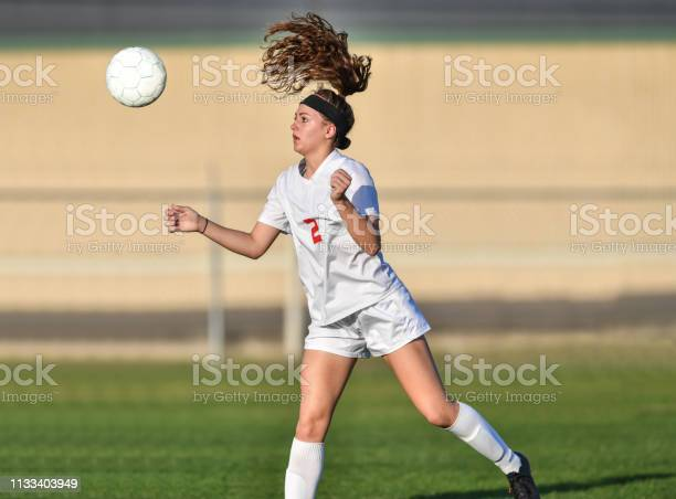 Young athletic girl playing with a soccer ball in a green grass field picture id1133403949?b=1&k=6&m=1133403949&s=612x612&h=x2qngolwzuiogvo8gdpa8gccrxsbtp2msx vfmfy6r8=