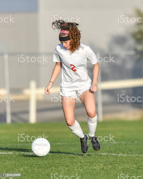Young athletic girl playing with a soccer ball in a green grass field picture id1133403999?b=1&k=6&m=1133403999&s=612x612&h=xmc8 lu3x g cxpsurtp3tcz0fykmkd 31jdk6xjlo4=