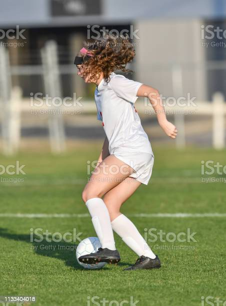 Young athletic girl playing with a soccer ball in a green grass field picture id1133404018?b=1&k=6&m=1133404018&s=612x612&h=eb3zqpyejuns2gjpunz00aryg2ypo dxufi9o2lnljs=