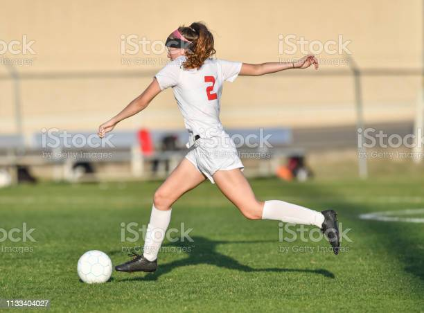 Young athletic girl playing with a soccer ball in a green grass field picture id1133404027?b=1&k=6&m=1133404027&s=612x612&h=ynxpfd j7q5flzth6bwufxsmtre4 jpcn4g8eswre6i=