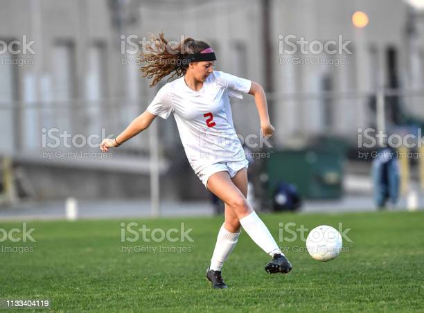 Young athletic girl playing with a soccer ball in a green grass field picture id1133404119?b=1&k=6&m=1133404119&s=612x612&h=lpdi4u9vbbdlqitbvyp4tlovx4puawonx1jiee1wjdm=