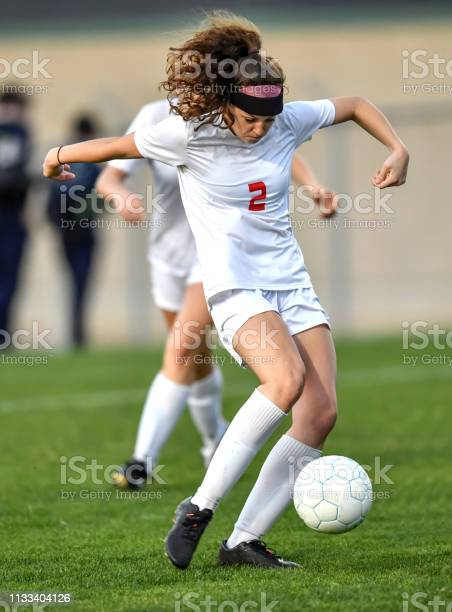 Young athletic girl playing with a soccer ball in a green grass field picture id1133404126?b=1&k=6&m=1133404126&s=612x612&h=ra7xnbktnpedplmdotmsq ur73 1gh9jl ylq5pviyo=