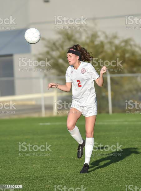 Young athletic girl playing with a soccer ball in a green grass field picture id1133404325?b=1&k=6&m=1133404325&s=612x612&h=ptjlur djy npekpltw7pp uaj6yatchx7ym0qjfzjs=