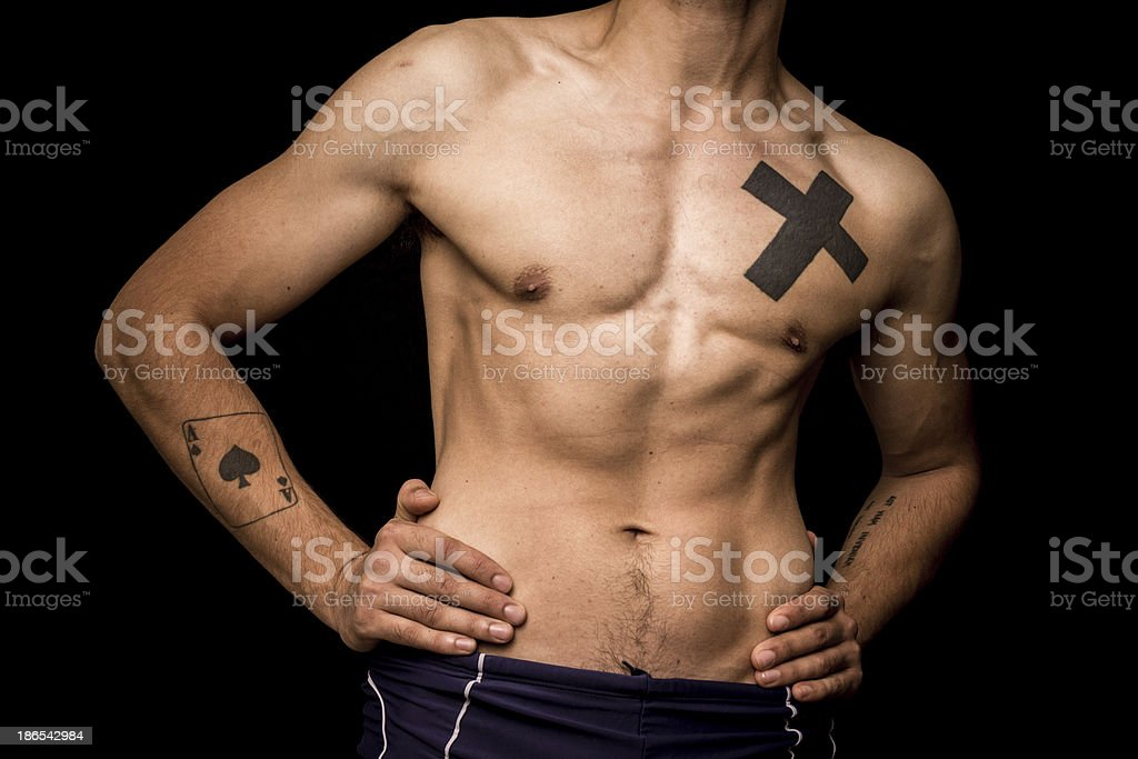 Young athletic shirtless man posing on black background royalty-free stock photo