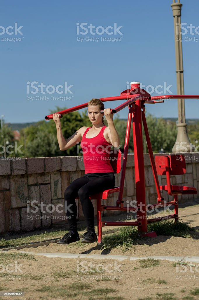 Young athletic woman exercising at outdoor gym. royalty-free stock photo