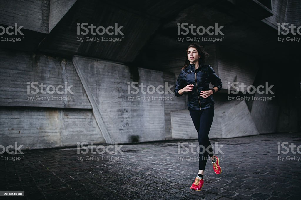 Young athletic woman running outdoor stock photo