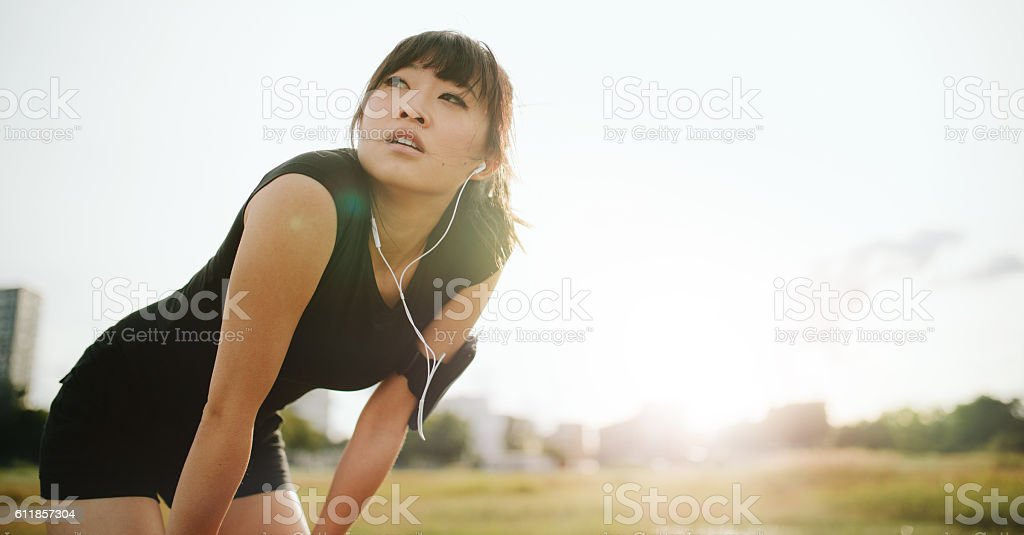 Young athletic woman taking a break from training stock photo