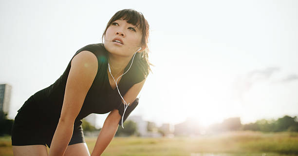 Young athletic woman taking a break from training - Photo