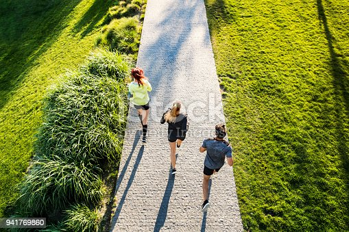 istock Young athtletes in the city running in park. 941769860