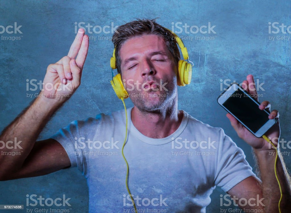 Young Attractive And Happy Cool Man Listening To Music Song