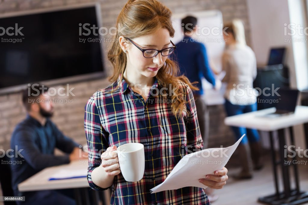 Young attractive architect working in modern office royalty-free stock photo