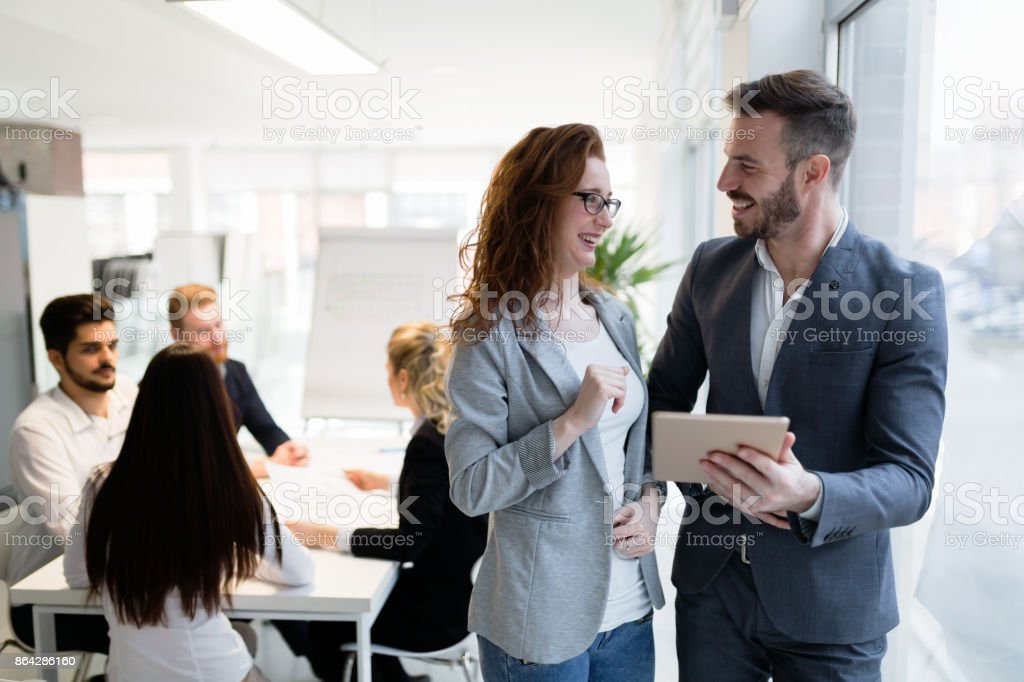 Young attractive architects using digital tablet in office royalty-free stock photo
