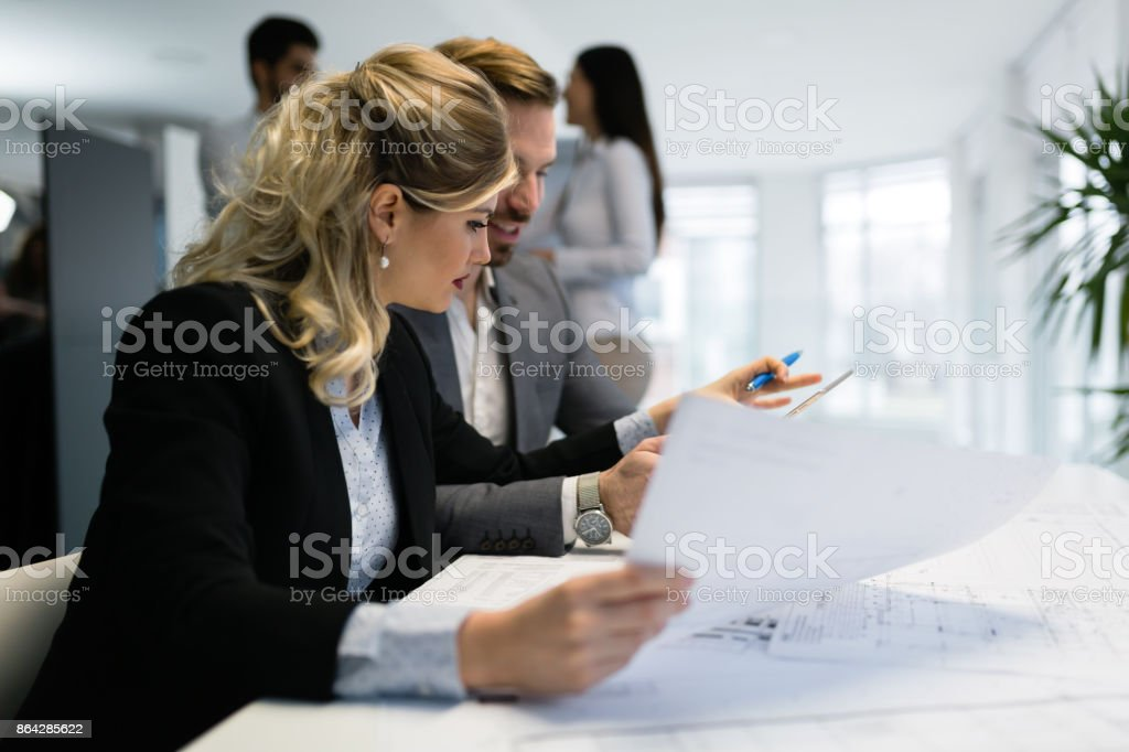 Young attractive architects working on project in office royalty-free stock photo