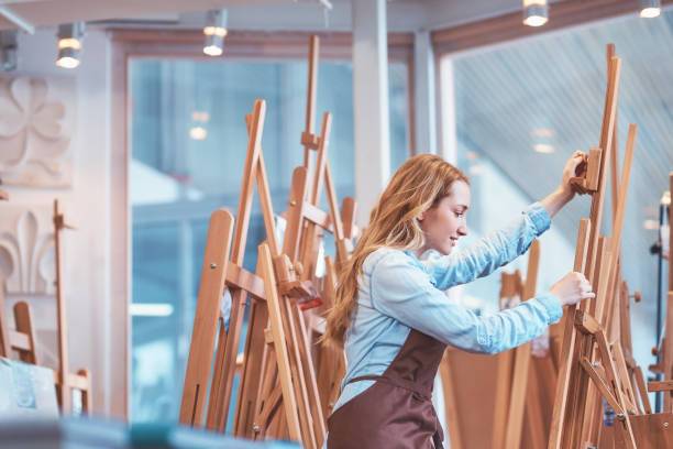 Young attractive artist at the easel stock photo