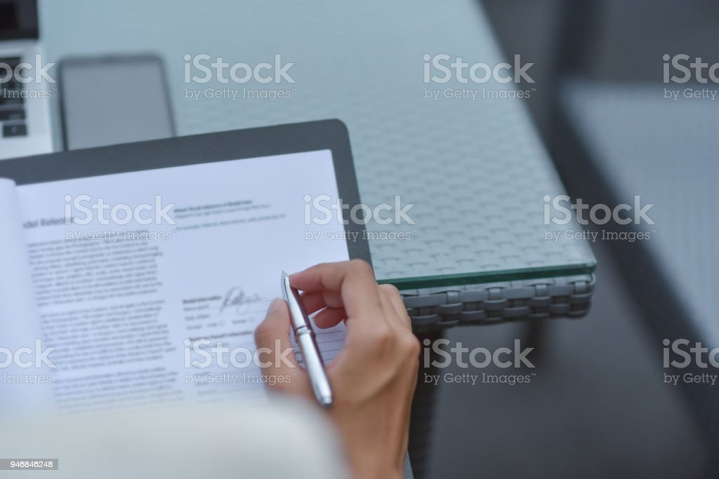Young attractive Asian business woman sleeping, drowsing or taking a nap at her desk, Tired business woman accountant with bills and paper folders in office, tired young business woman with laptop. stock photo