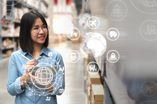 Young attractive asian manager woman looking, picking, replemishment, receiving inventory at store warehouse in warehouse management system concept. Smart ERP with iot for inventory management. stock photo