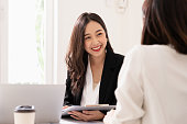 istock A young attractive asian woman is interviewing for a job. Her interviewers are diverse. Human resources manager conducting job interview with applicants in office 1207265013