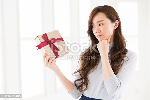 874218810 istock photo young attractive asian woman 1129748455