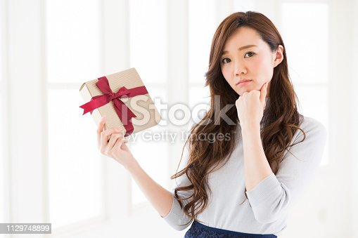 874218810 istock photo young attractive asian woman 1129748899