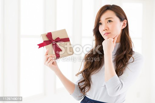874218810 istock photo young attractive asian woman 1129749019