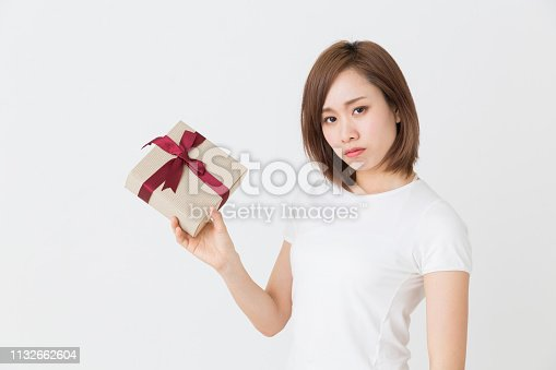 874218810 istock photo young attractive asian woman 1132662604