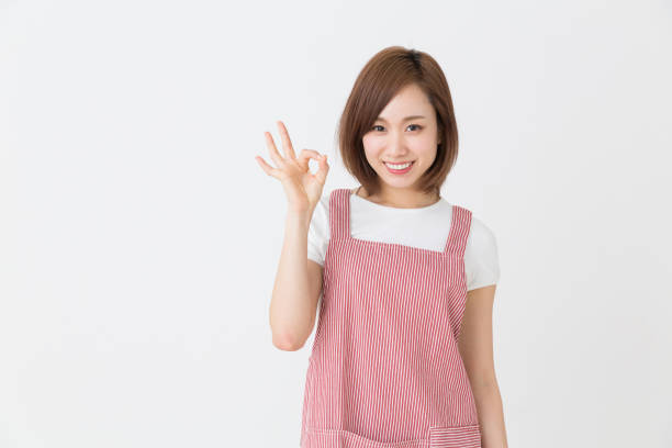 young attractive asian woman young attractive asian woman who cooks homemaker stock pictures, royalty-free photos & images