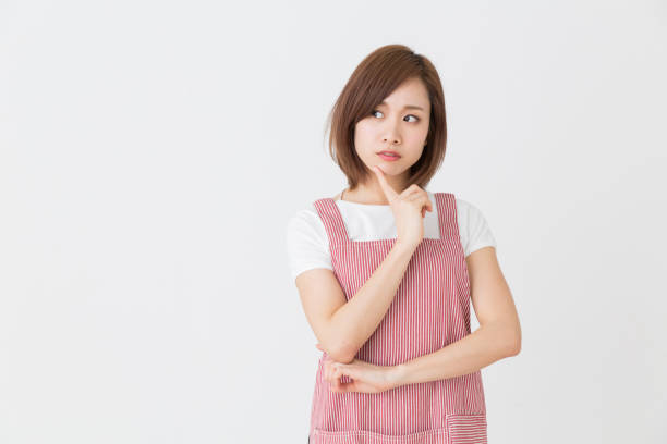 young attractive asian woman young attractive asian woman who cooks, think, homemaker stock pictures, royalty-free photos & images