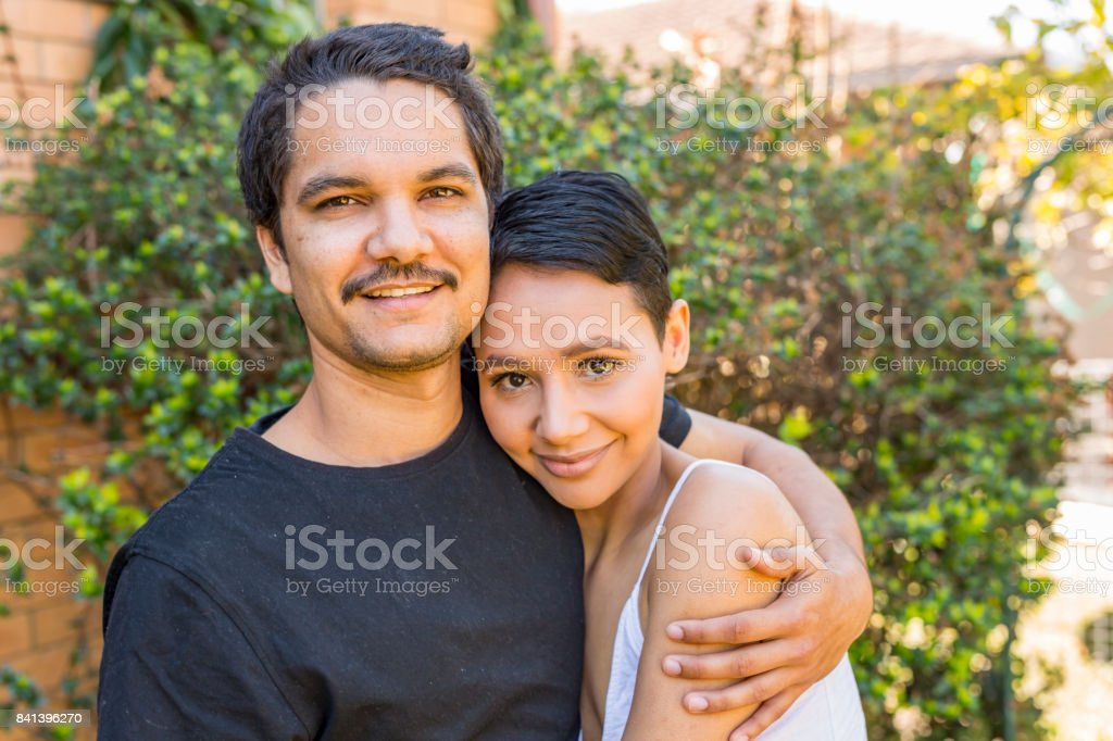 Young Attractive Australian Aboriginal Couple at Home stock photo