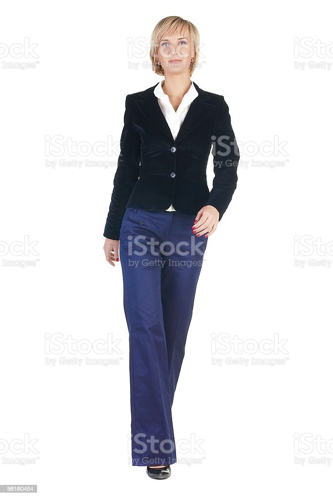 Young attractive blonde businesswoman walking royalty-free stock photo