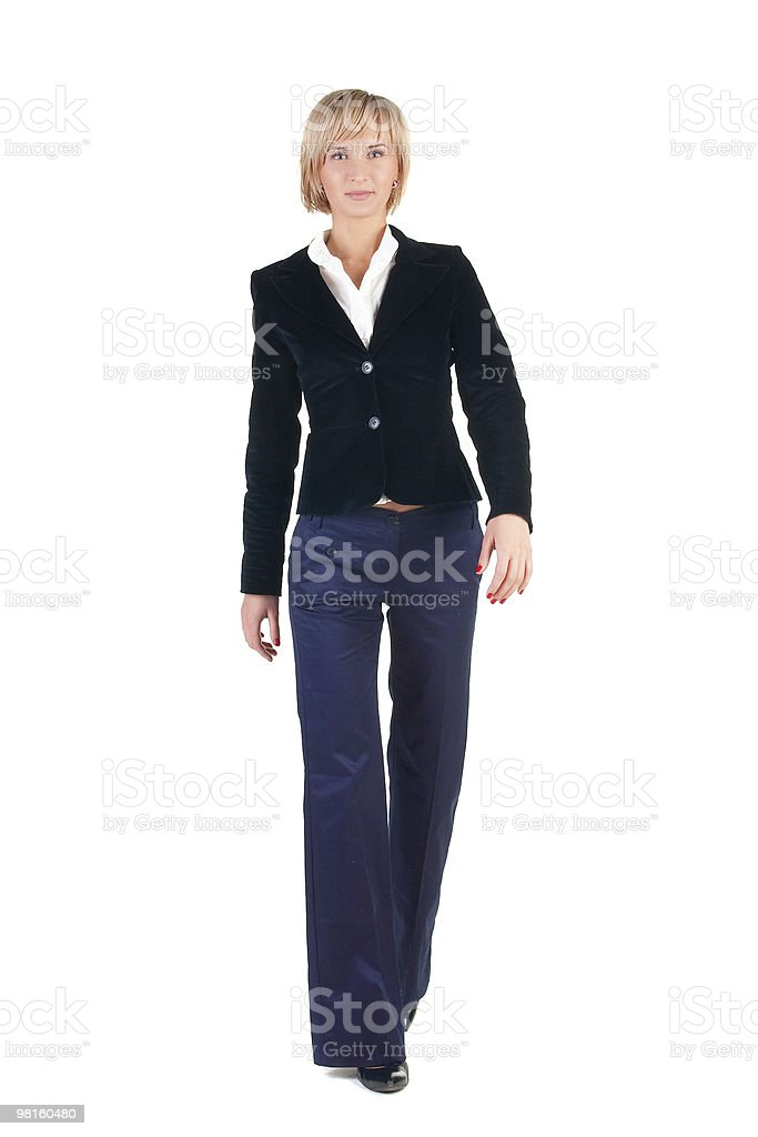 Young attractive blonde businesswoman walking. royalty-free stock photo