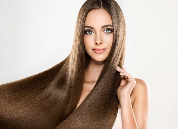 Young attractive brunette girl model with gorgeous, straight, brown hair. stock photo