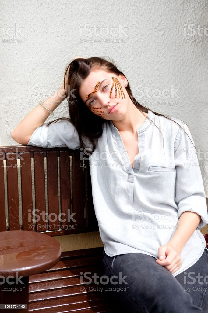 Young Attractive Brunette Woman With Tiger Colored Tapes