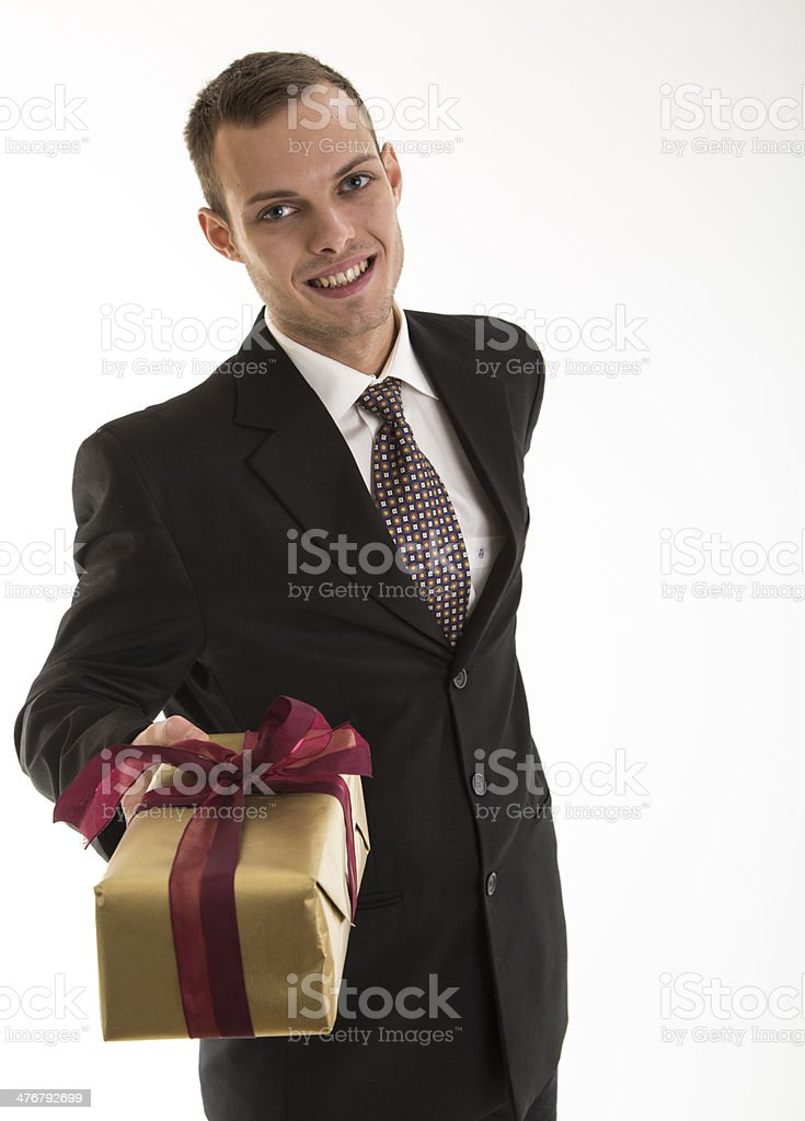 young attractive business man with gift pack royalty-free stock photo