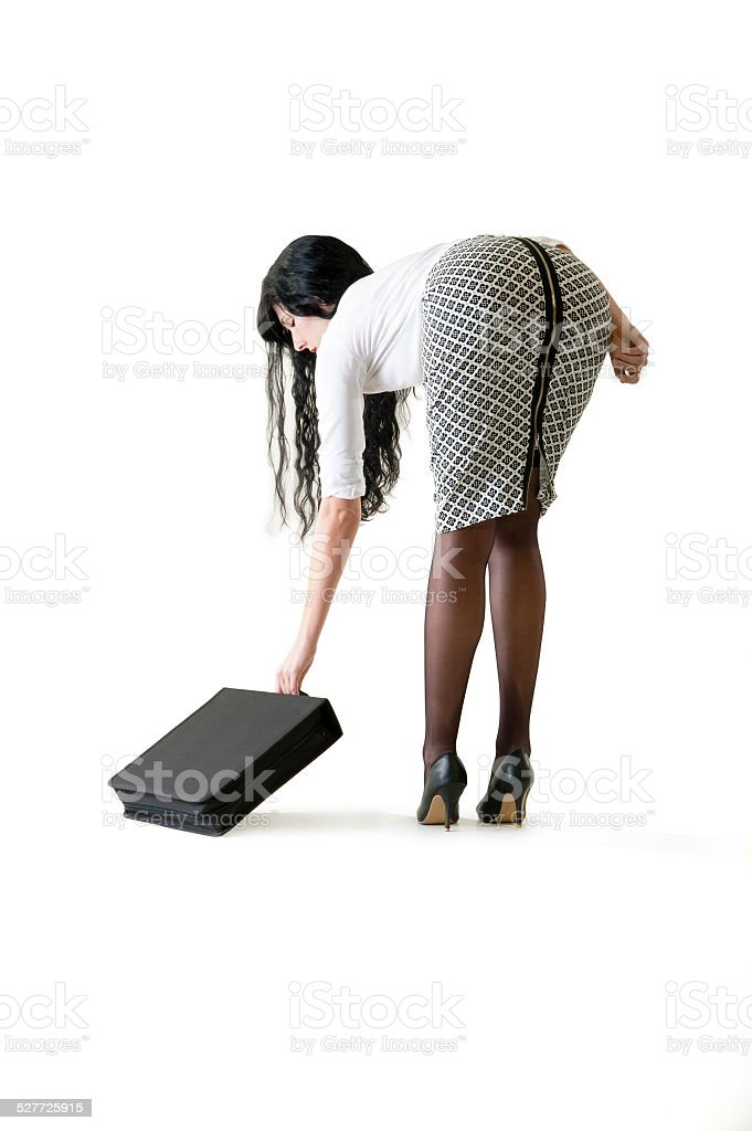Young attractive business woman reaching for her attaché case stock photo