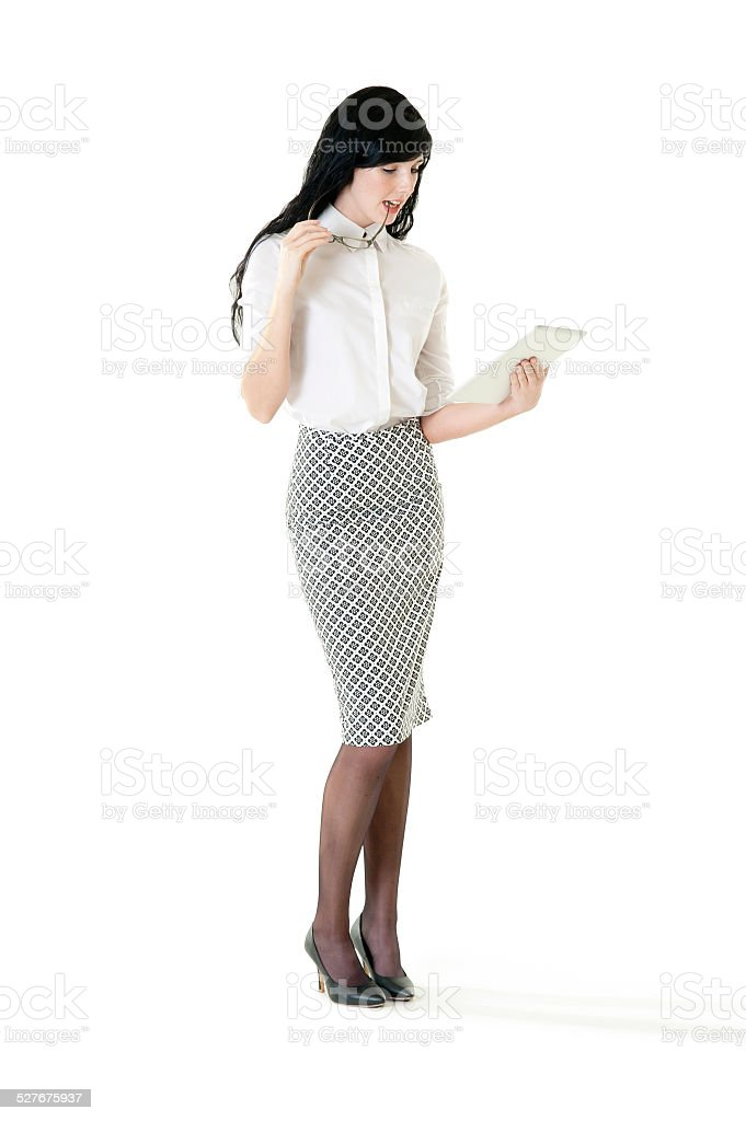 Young attractive business woman working on electronic tablet stock photo