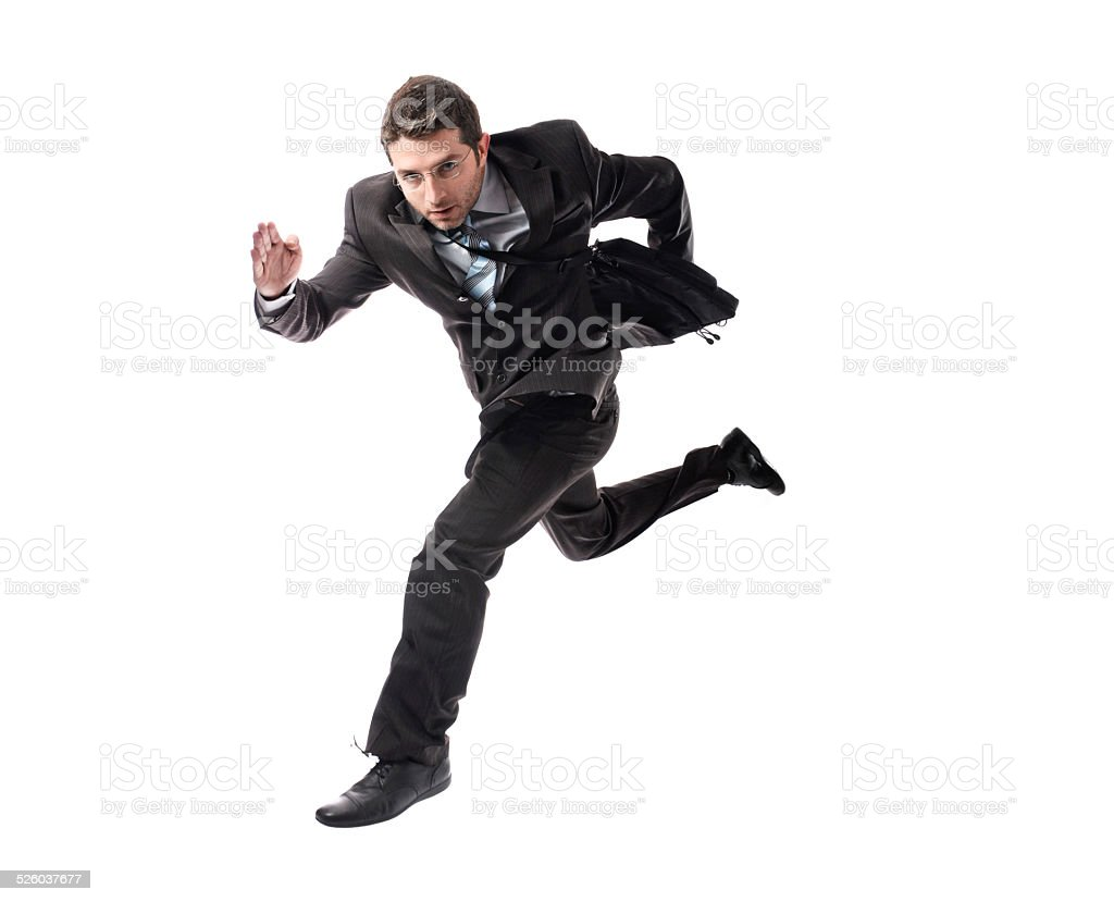 young attractive businessman running late to work  in stress stock photo