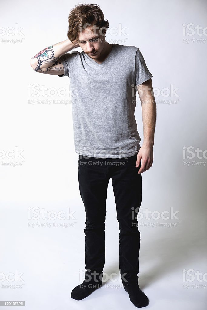 Young Attractive Caucasian Tattoo Hipster Man on White Background stock photo