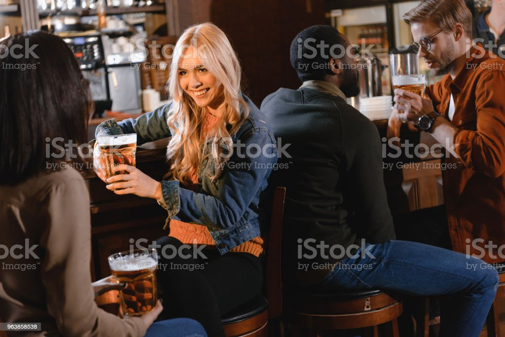 young attractive company of friends spending time at bar - Royalty-free Adult Stock Photo