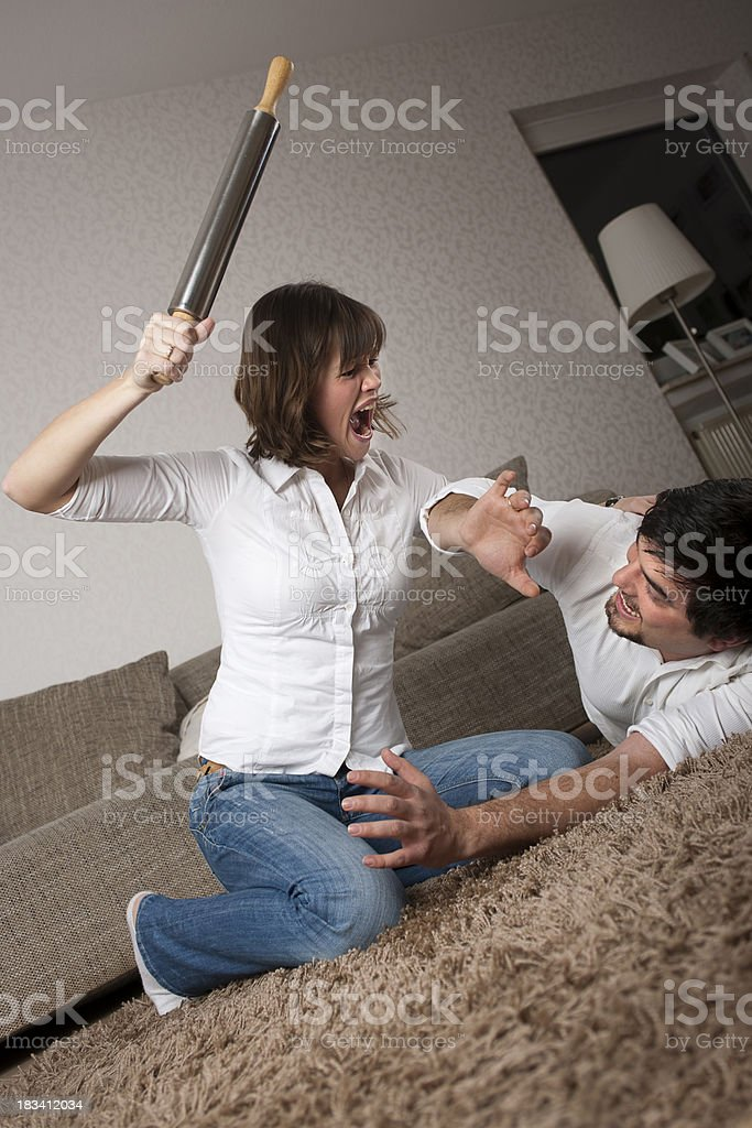 Young attractive couple beating each other royalty-free stock photo