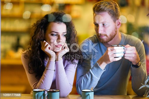 istock Young attractive couple having problems on date 1059177568