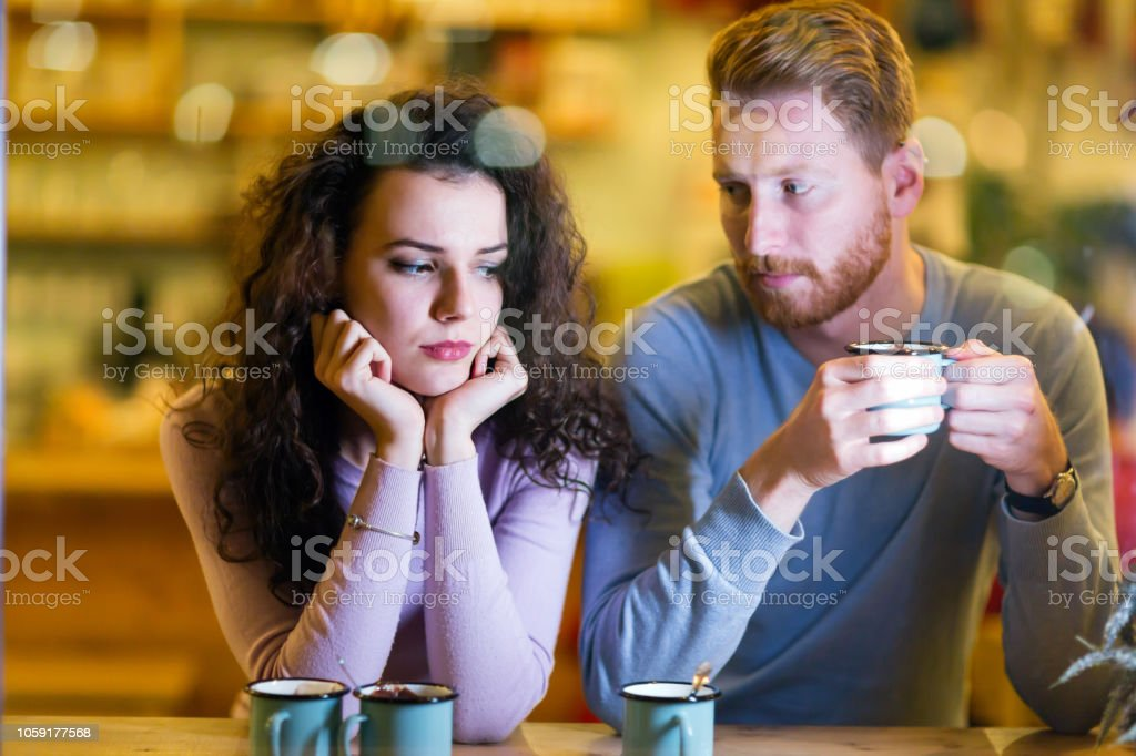 Young attractive couple having problems on date stock photo