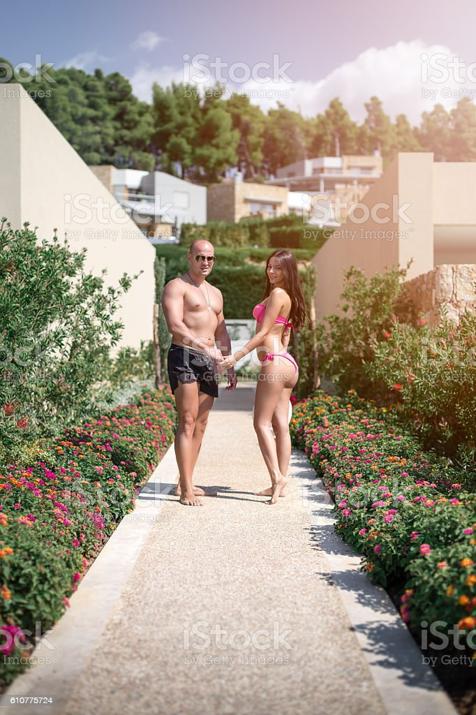 Young attractive couple walking in the summer resort stock photo