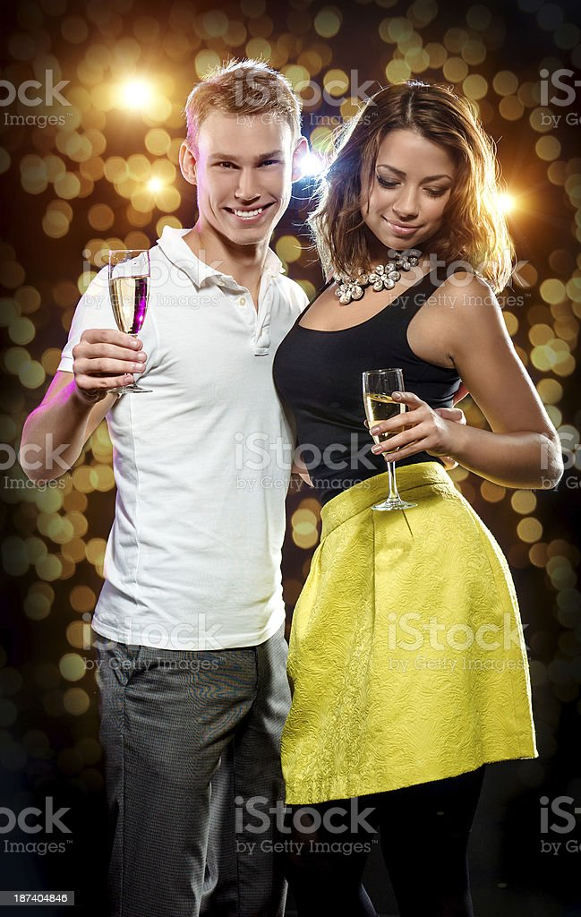 Young attractive couple with glasses of sparkling champagne royalty-free stock photo